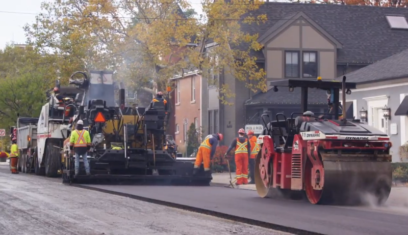 Image of a construction crew resurfacing a road