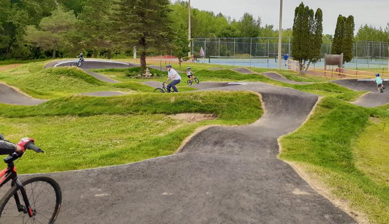 A photograph of cyclists using the Perth Pump Track.