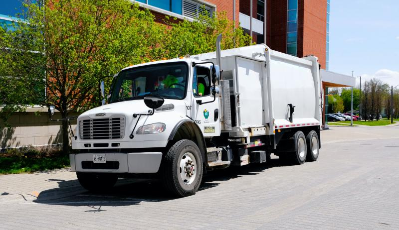 A photograph of a recycling truck in the City of Woodstock, Ontario.